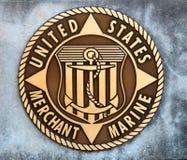 Stany Zjednoczone Handlowego żołnierza piechoty morskiej moneta w betonowej płycie fotografia royalty free