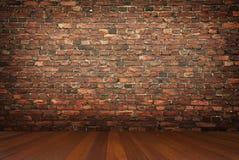Stanza con il muro di mattoni immagini stock