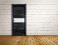 Stanza del mattone con la porta moderna Fotografia Stock Libera da Diritti