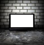 Stanza di Grunge e plasma TV Fotografie Stock