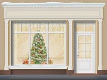 Stanza frontale di negozio con la vetrina decorata per il Natale Fotografia Stock Libera da Diritti