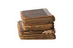 Stapel alte Bücher auf einem weißen Hintergrund Stockfotos