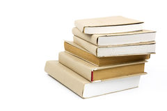 Stapel alte Bücher lokalisiert auf Weiß Stockfotografie