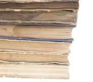 Stapel alte Bücher lokalisiert auf weißem Hintergrund Stockfotografie
