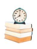 Stapel alte Bücher mit Uhr Lizenzfreies Stockbild