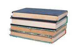 Stapel alte benutzte Bücher lokalisiert Stockfotos