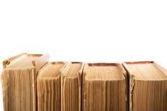 Stapel alte und benutzte Bücher oder Lehrbücher des gebundenen Buches an lokalisiert Stockbilder