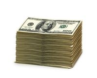 Stapel Amerikaanse dollars die op wit worden geïsoleerdd stock foto's