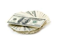 Stapel Amerikaanse dollars die op wit worden geïsoleerde Stock Fotografie