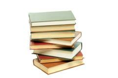 Stapel Bücher getrennt auf weißem Hintergrund Lizenzfreie Stockfotos