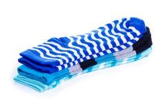 Stapel blauwe sokken stock afbeeldingen