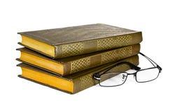 Stapel boeken met een paar oogglazen Stock Afbeelding