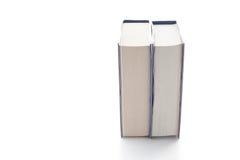 Stapel der alten Bücher getrennt auf weißem Hintergrund Lizenzfreies Stockfoto