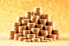 Stapel der alten goldenen Münzen Stockbilder