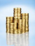 Stapel der Goldmünzen Stockfotos