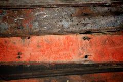 Stapel des alten roten und schwarzen hölzernen Brettes Lizenzfreie Stockfotografie
