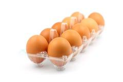 Stapel des braunen Eies auf weißem Hintergrund Lizenzfreies Stockbild