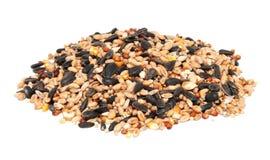 Stapel des Vogelstartwertes für zufallsgenerator einschließlich Sonnenblumensamen, Weizen und Mais Lizenzfreie Stockbilder