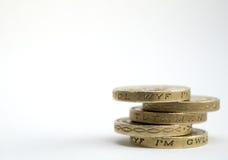 Stapel ein-Pfund-Münzen Stockbilder