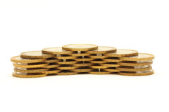 Stapel goldene Münzen getrennt auf Weiß Stockbild