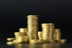 Stapel Goldmünzen Stockbilder
