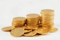 Stapel Münzen des goldenen Adlers Stockbild
