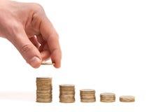 Stapel Münzen mögen Diagramm mit Reflexion und h Stockfoto