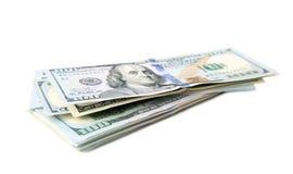 Stapel ons dollars op wit worden geïsoleerd dat Royalty-vrije Stock Afbeelding