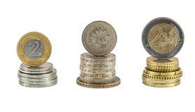 Stapel poetsmiddel zloty pond en euro muntstukken Royalty-vrije Stock Foto