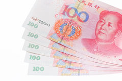Stapel Renminbi (RMB) bankbiljetten, 100 honderd dollars Stock Fotografie