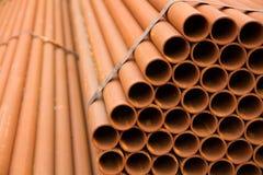 Stapel Stahlrohre Stockbilder
