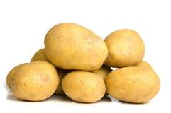 Stapel van aardappels die op wit worden geïsoleerds Stock Foto's