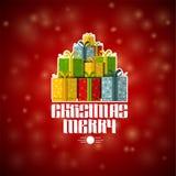 Stapel van ambacht-dozen bij Kerstmis het van letters voorzien op rood Stock Fotografie