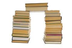 Stapel van boeken die op wit worden geïsoleerdi Stock Foto's