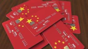 Stapel van creditcards met vlag van China Het Chinese bankwezensysteem conceptuele 3D teruggeven stock illustratie