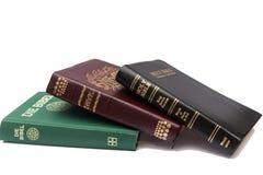 Stapel van drie Heilige Bijbels Stock Afbeeldingen