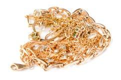 Stapel van gouden juwelen Stock Foto's