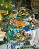Stapel van kleurrijke dekens in een markt vector illustratie