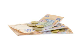Stapel van moderne bankbiljetten en verscheidene muntstukken van Oekraïense hryvnia Royalty-vrije Stock Afbeelding