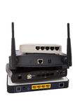 Stapel van netwerkapparaten op witte achtergrond Stock Fotografie