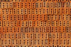 Stapel van oranje bakstenen voor patroon en bouw Royalty-vrije Stock Afbeeldingen