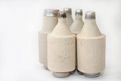 Stapel van oude ceramische zekeringen Stock Foto