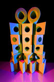 Stapel van stuk speelgoed bakstenen in gekleurd licht Royalty-vrije Stock Fotografie
