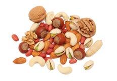Stapel van verschillende soorten noten () Stock Foto's