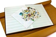 Stapel van zegels op album Stock Foto's