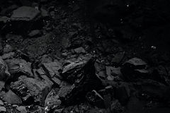 Stapel van zwarte steenkool voor textuur Royalty-vrije Stock Fotografie