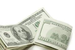 Stapel von 100 Dollarscheinen einer gefaltet Stockbilder