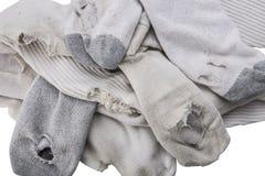 Stapel von alten Socken mit den Löchern obenliegend Lizenzfreie Stockfotografie
