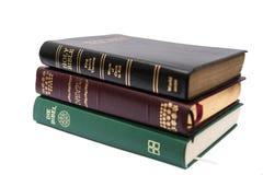 Stapel von drei heiligen Bibeln Stockbilder