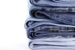 Stapel von Jeans lizenzfreie stockbilder